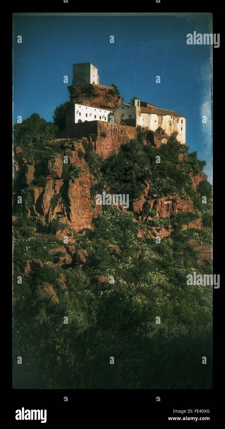 Low Angle View Of Hermitage Mare De Deu De La Roca Against Sky - Stock Image