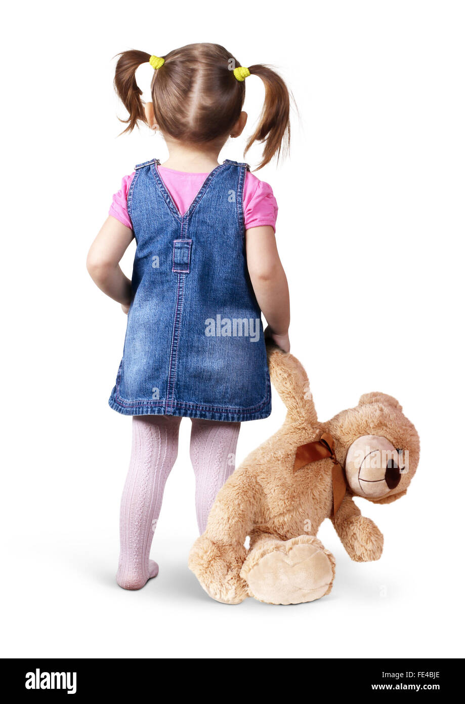 Little child girl with toy bear on white, back view - Stock Image