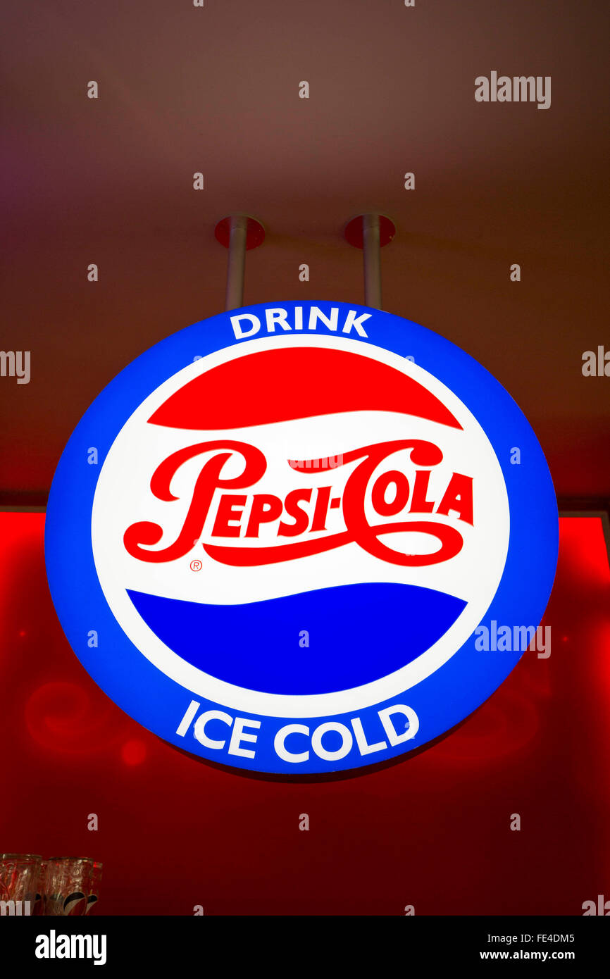 A traditional Pepsi-Cola neon sign in a UK Pizza Hit restaurant - Stock Image