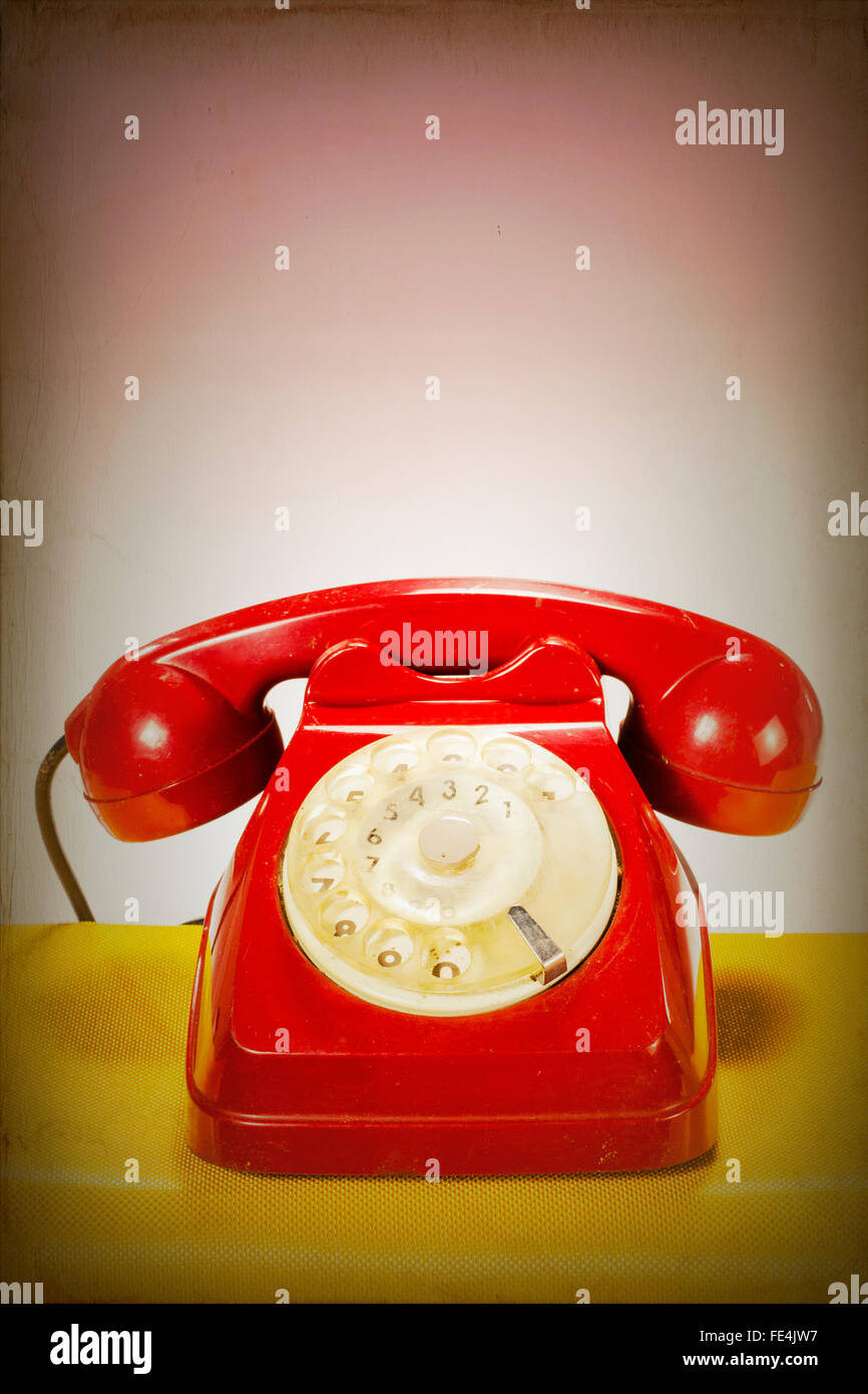 Retro Red Telephone Over White Background - Stock Image