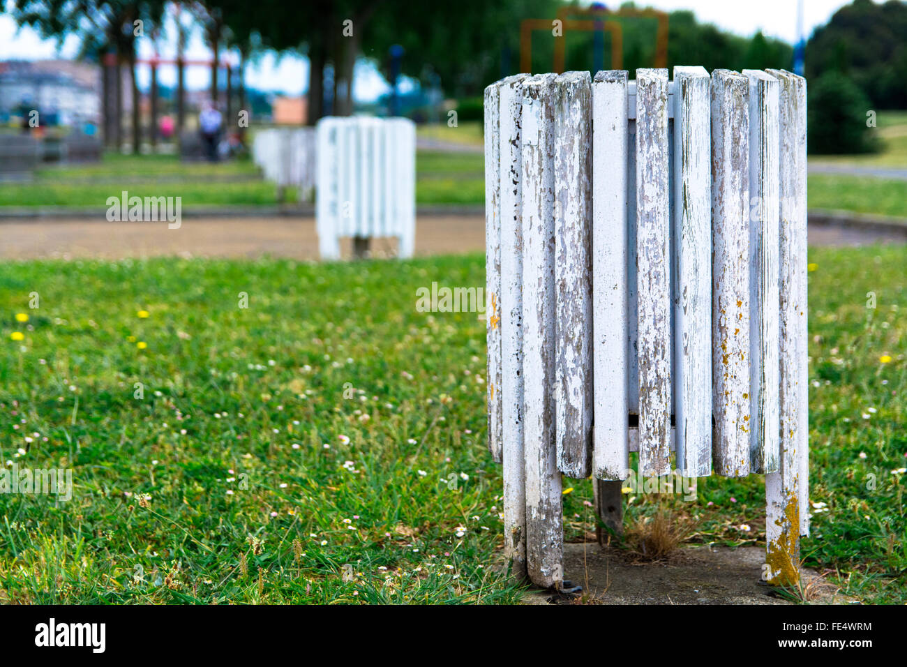 Close-Up Of Wooden Rubbish Bin In Park - Stock Image