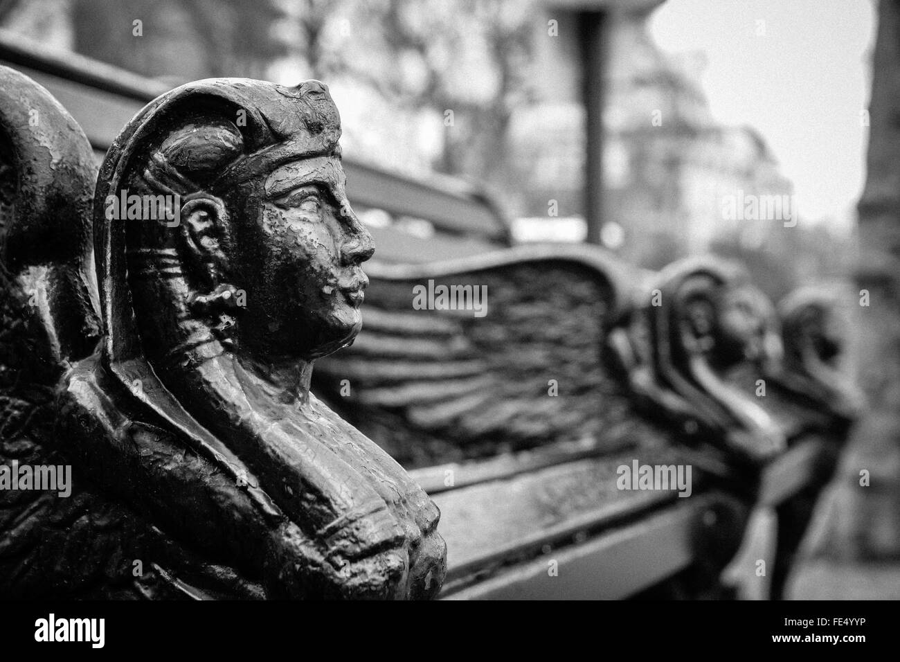 Close-Up Side View Of Effigy Bench Against Blurred Background - Stock Image