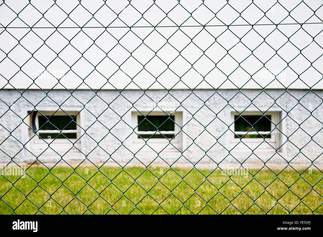 fence, mesh wire fence, chain link fence - Stock Image