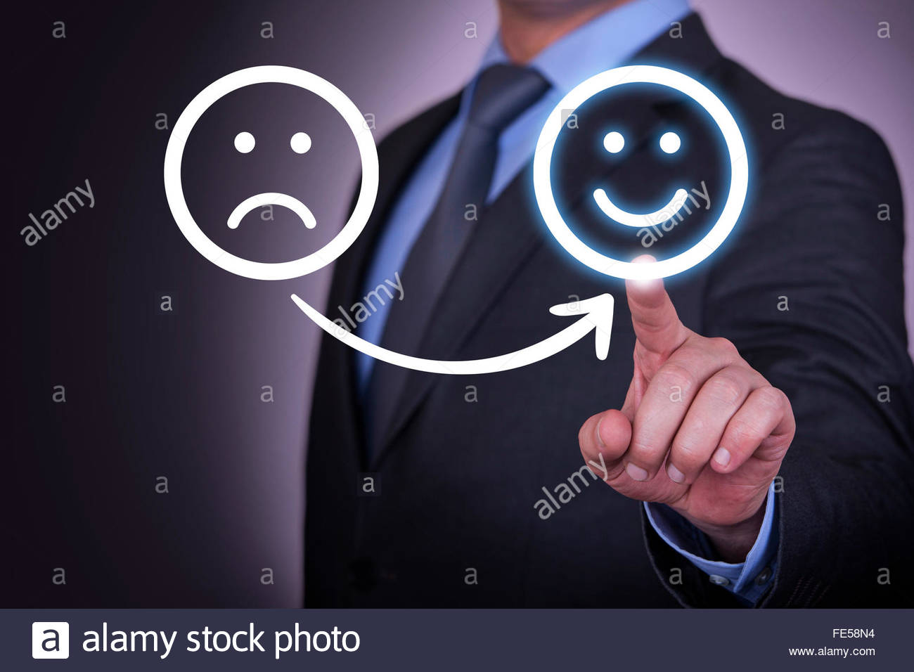 Unhappy and Happy Smiley on Screen - Stock Image
