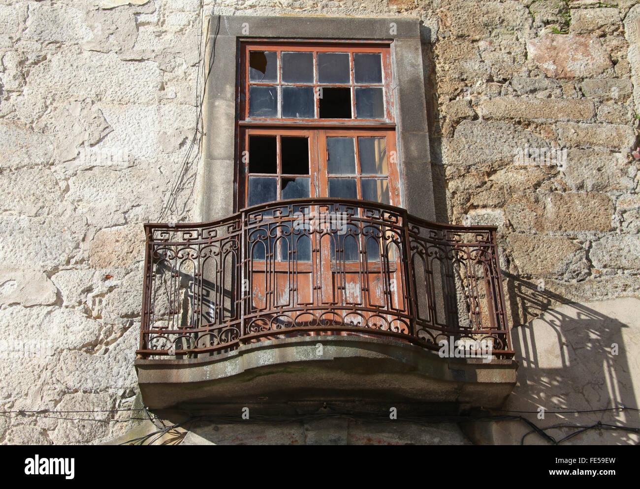 Old window in the Portuguese city of Porto - Stock Image