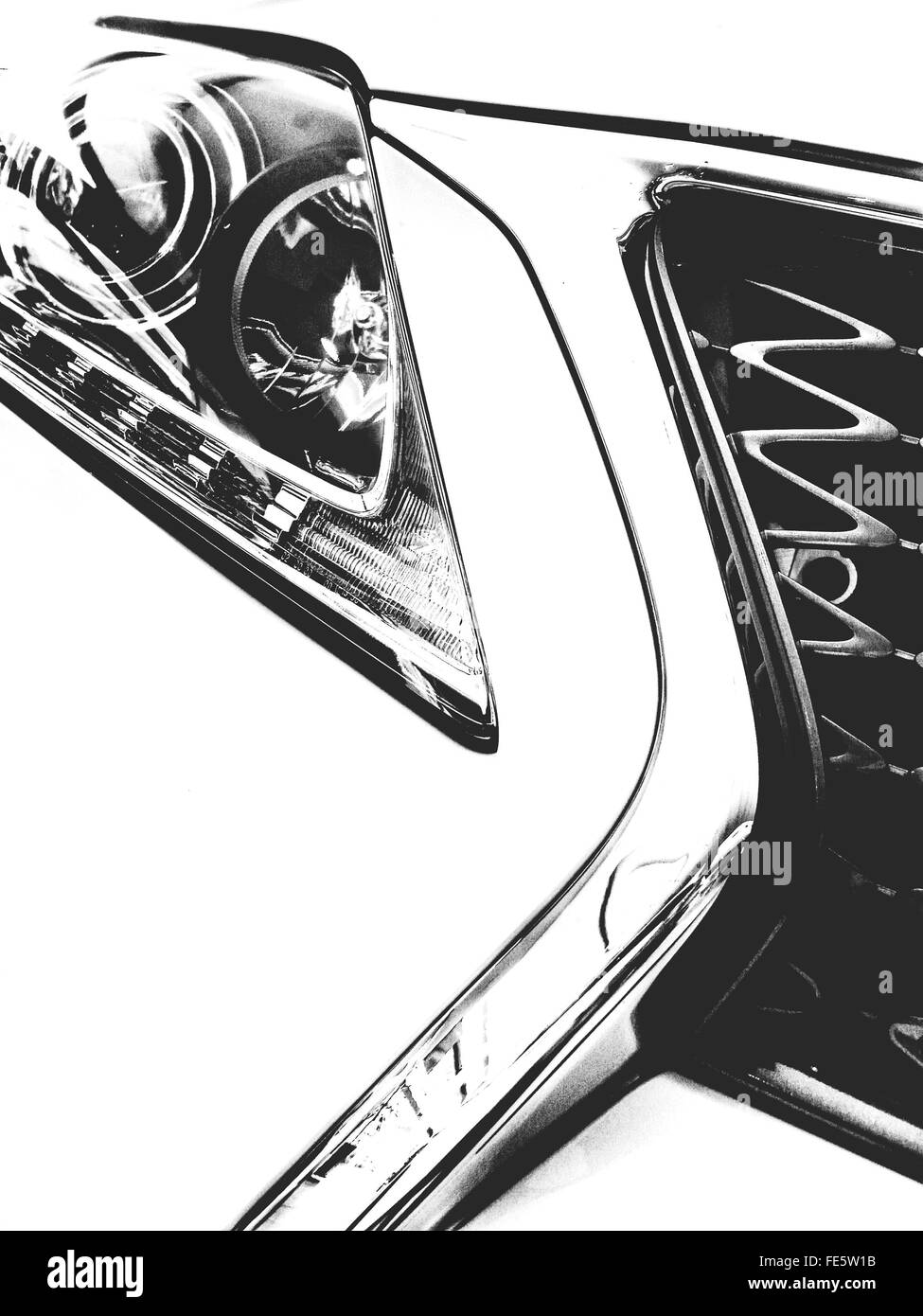 Close-Up Of Luxury Car Headlight And Grille - Stock Image