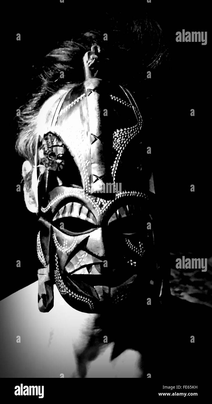 Man wearing traditional african mask stock image