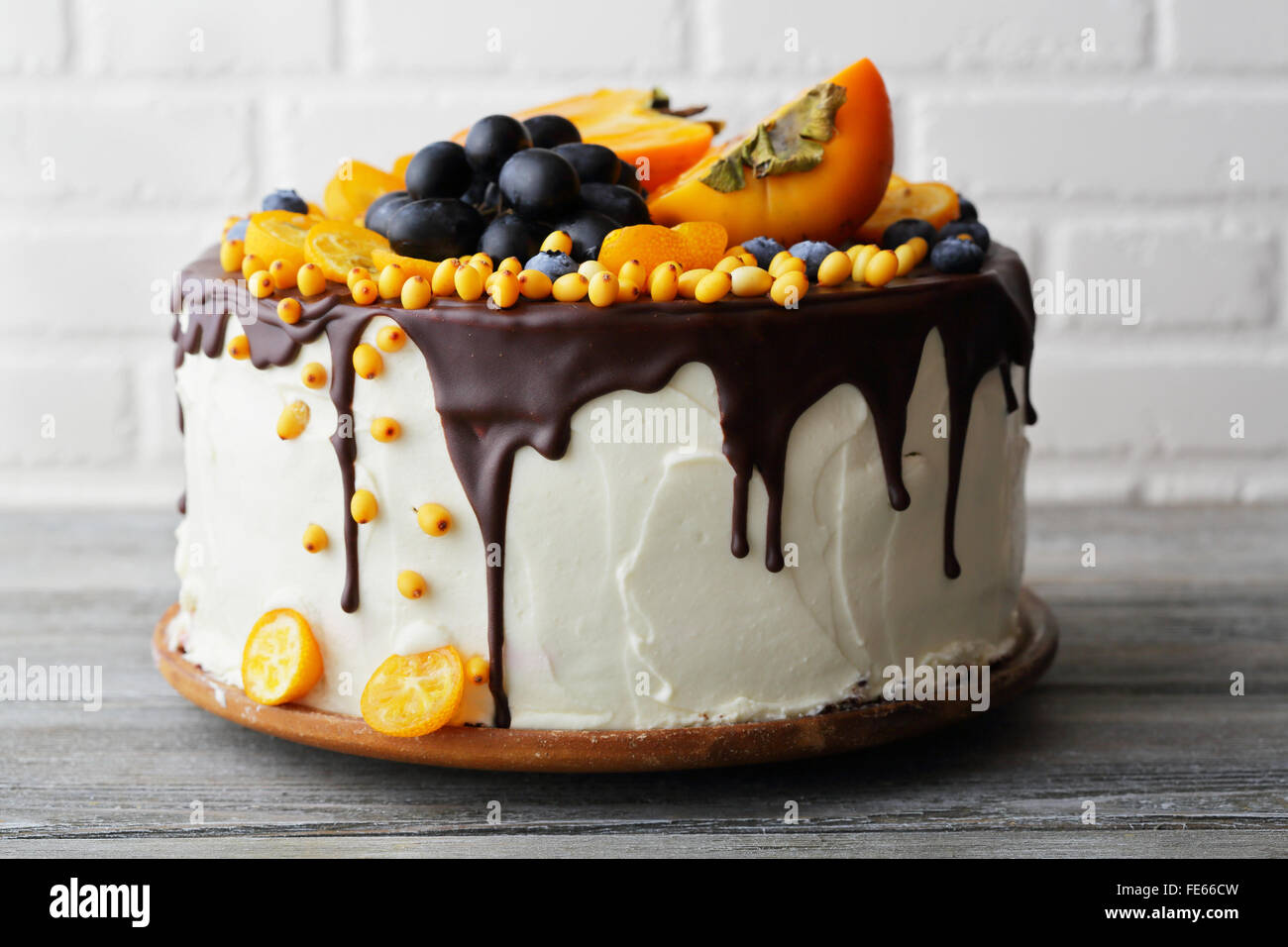 cake with fruits and cream, food closeup - Stock Image