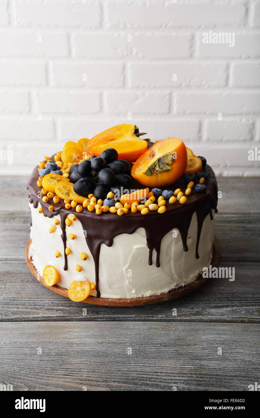 cake with autumn fruits on top, food - Stock Image