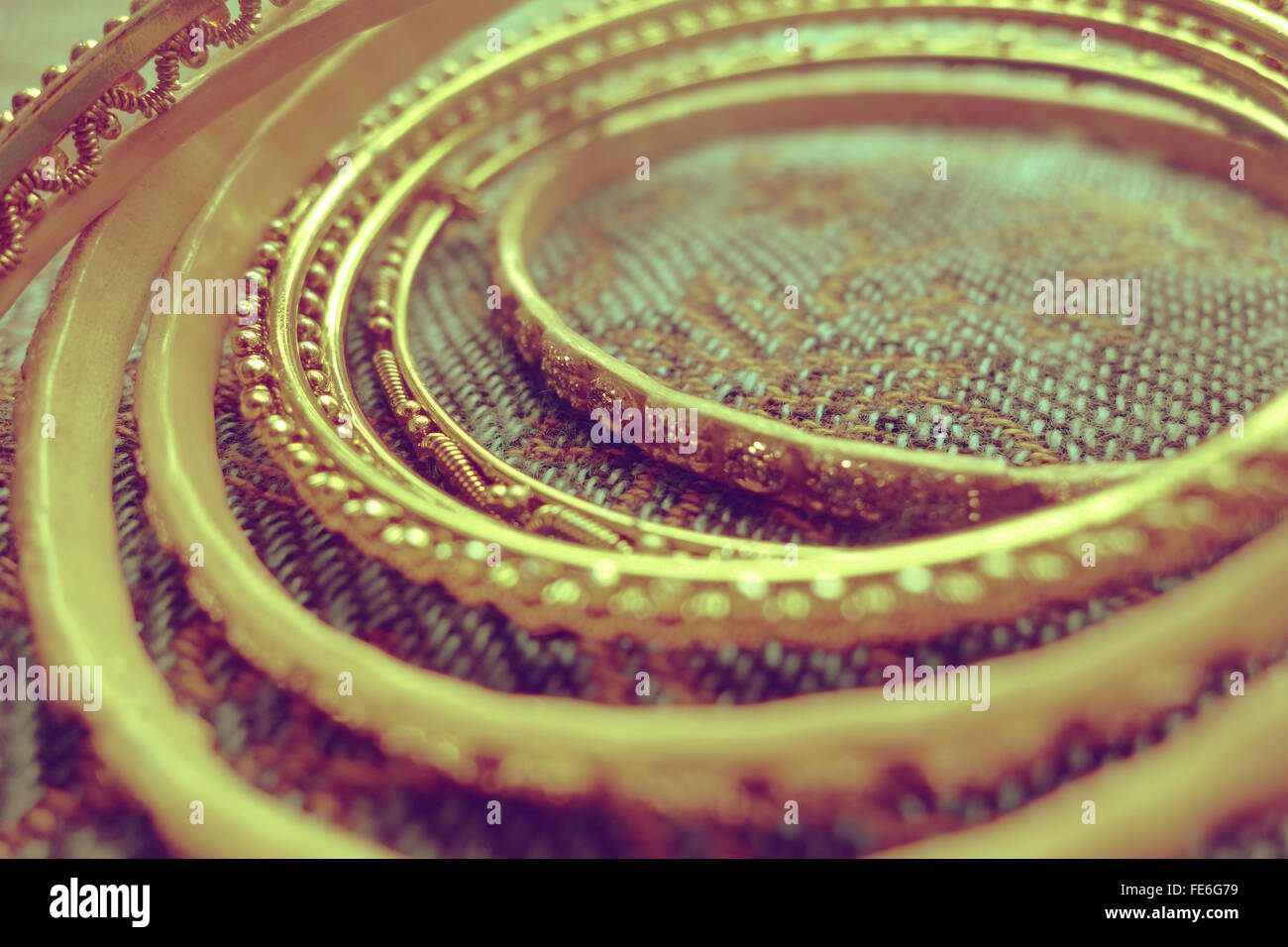 Extreme Close-Up Of Gold Colored Bangles - Stock Image