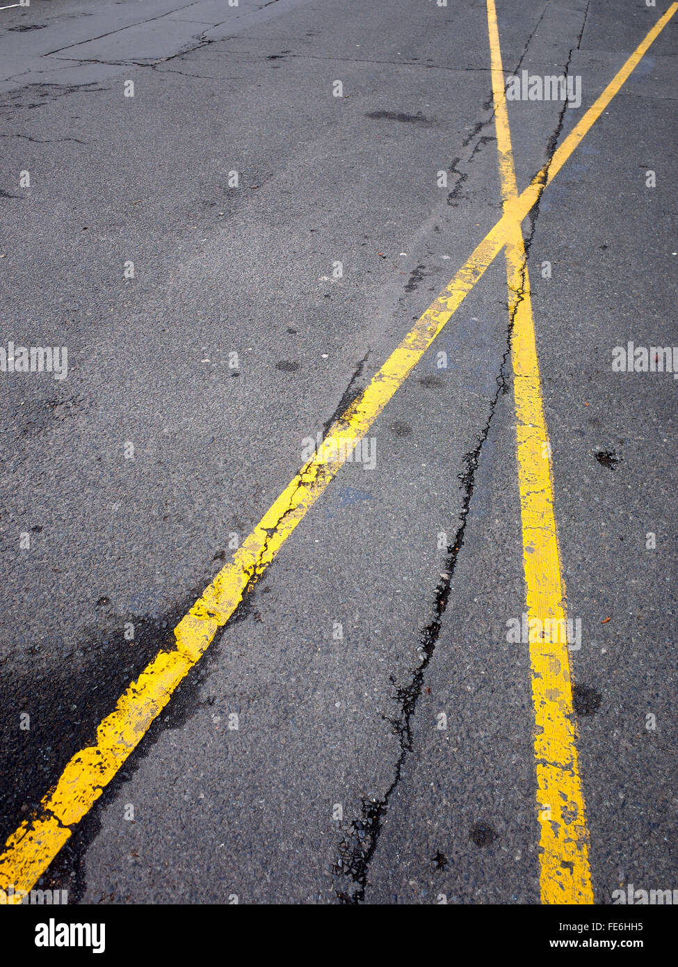 High Angle View Of Yellow Cross Road Markings On Street - Stock Image