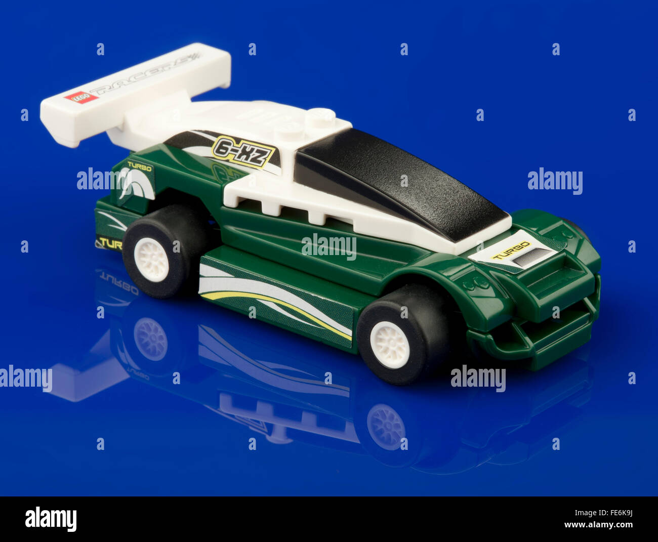 Lego racer toy car on blue background - Stock Image