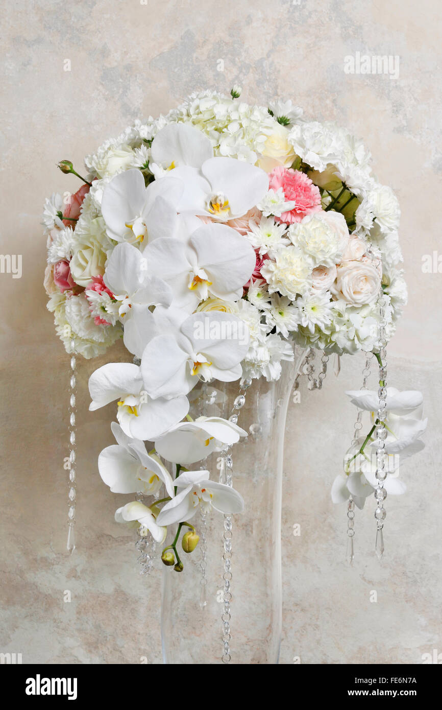Floral arrangement with white orchids, carnations and chrysanthemums ...