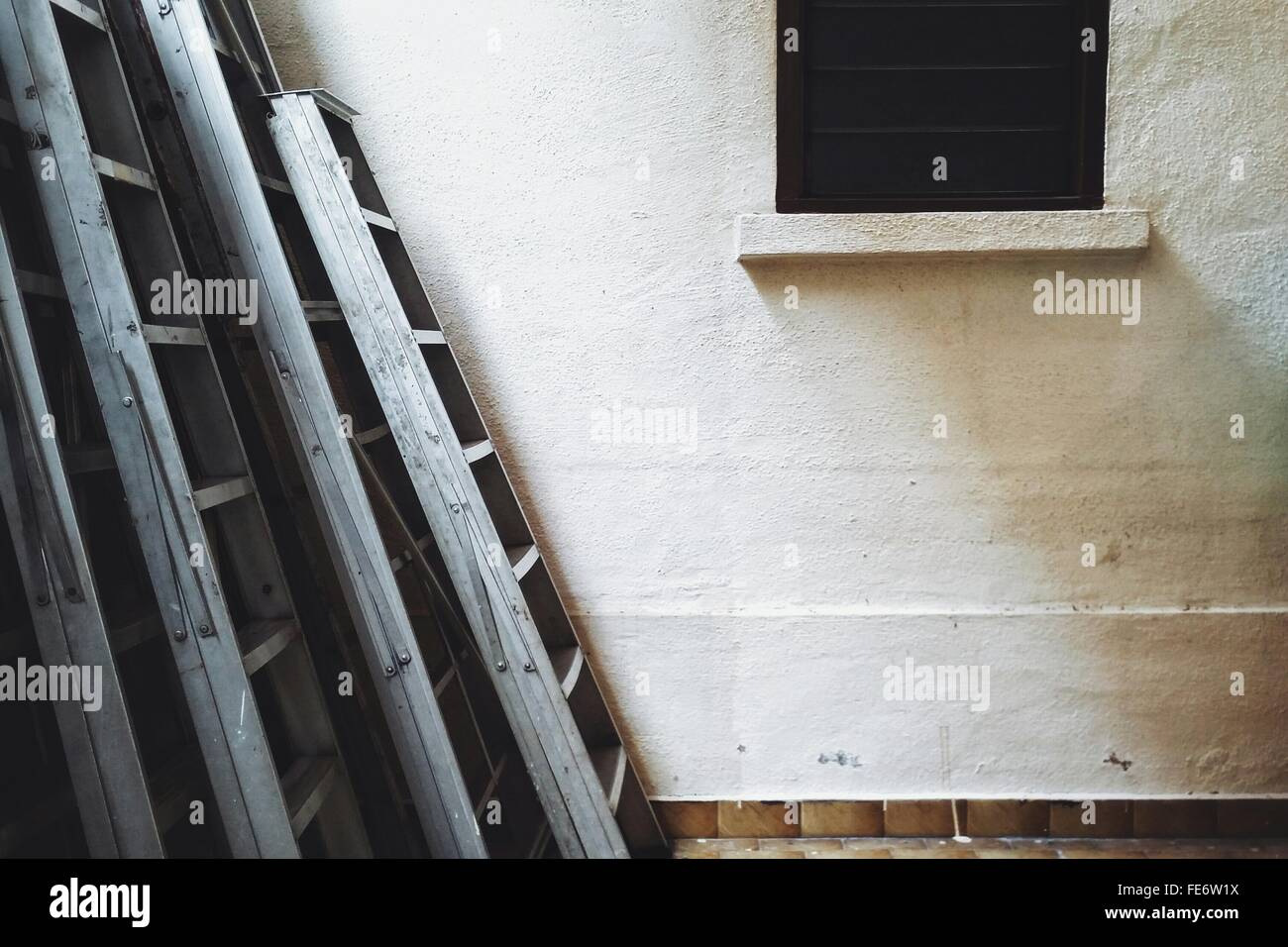 Ladders Outside House - Stock Image