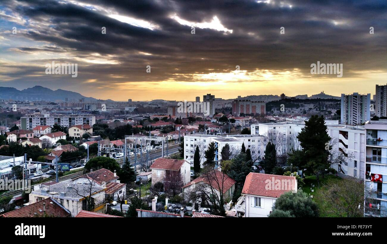 High Angle View Of Cityscape Against Cloudy Sky At Les Pennes-Mirabeau - Stock Image