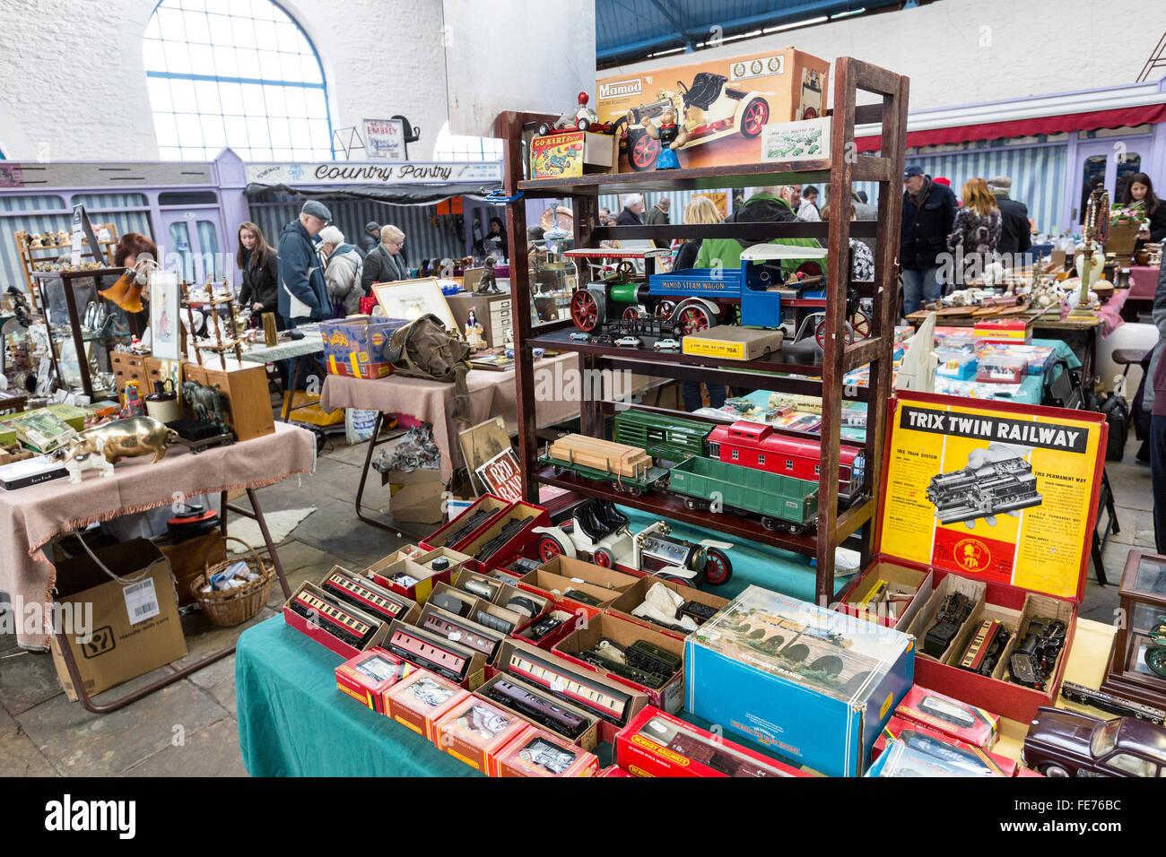 Indoor antique flea market with toy trains on sale, Abergavenny, Wales, UK - Stock Image