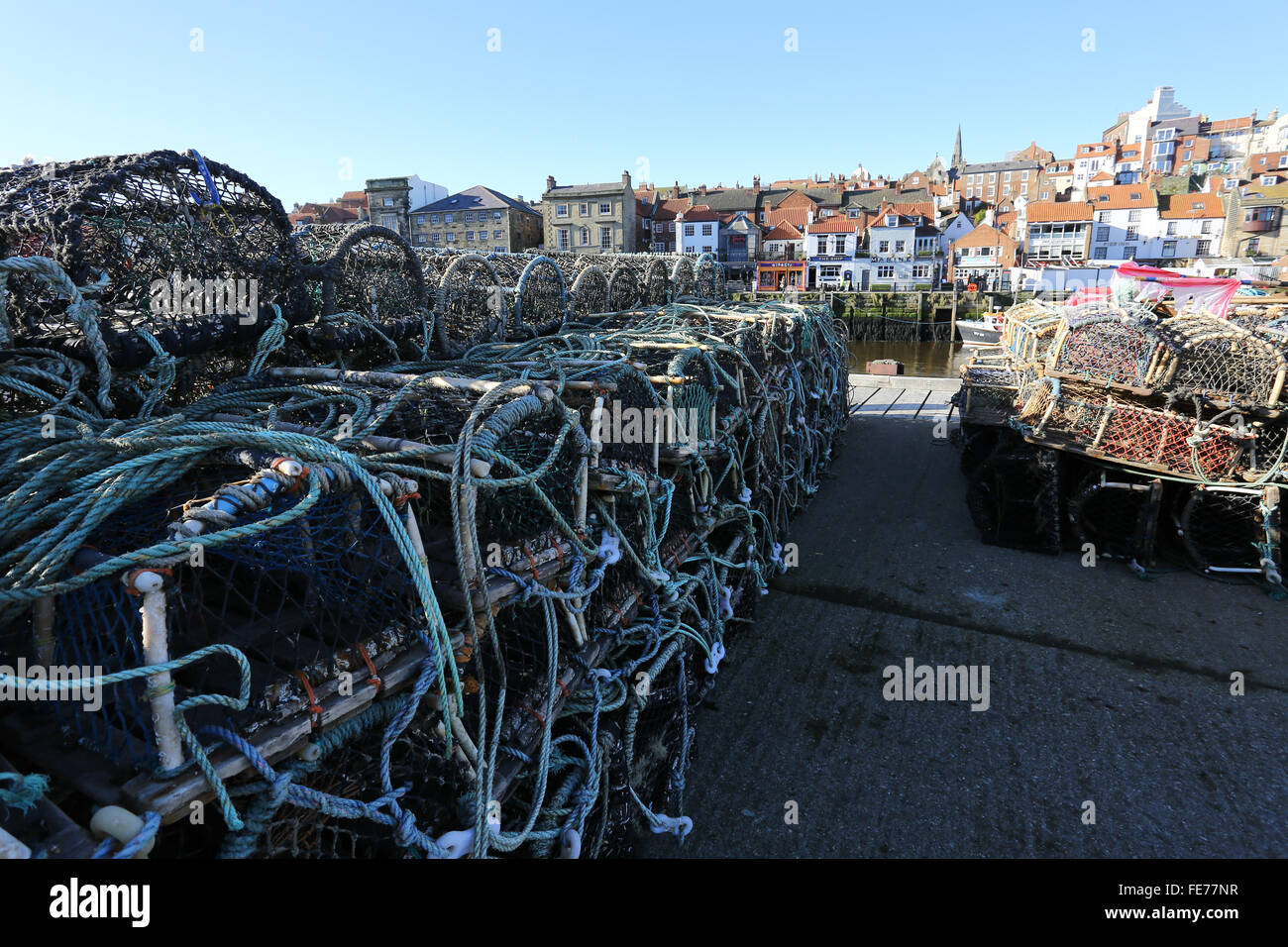 Stacks Of Crab Pots At Fishing Industry By Residential District - Stock Image