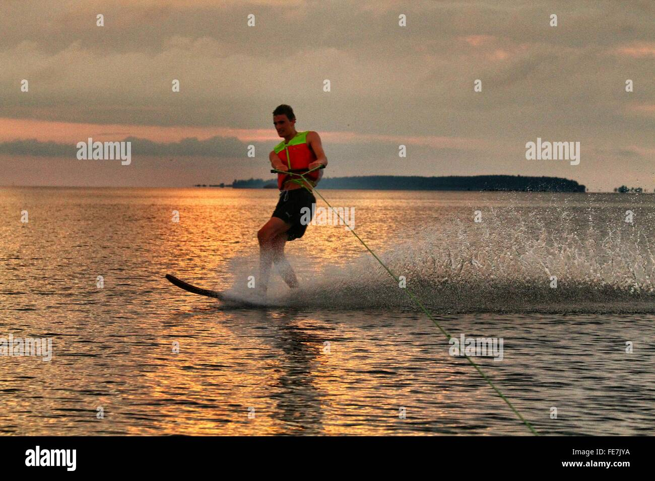 Full Length Of Man Wakeboarding - Stock Image