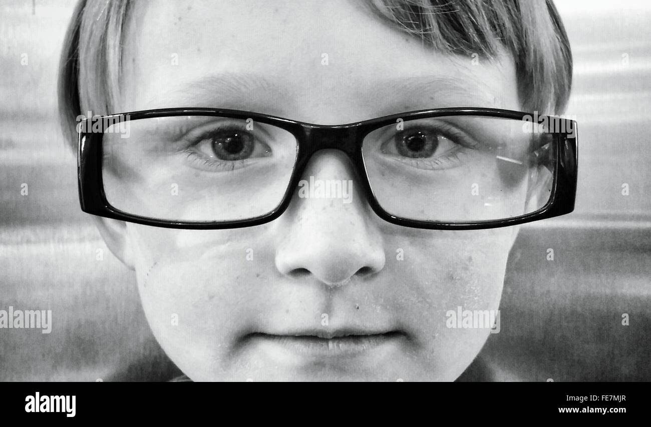 Portrait Of Boy Wearing Eyeglasses - Stock Image
