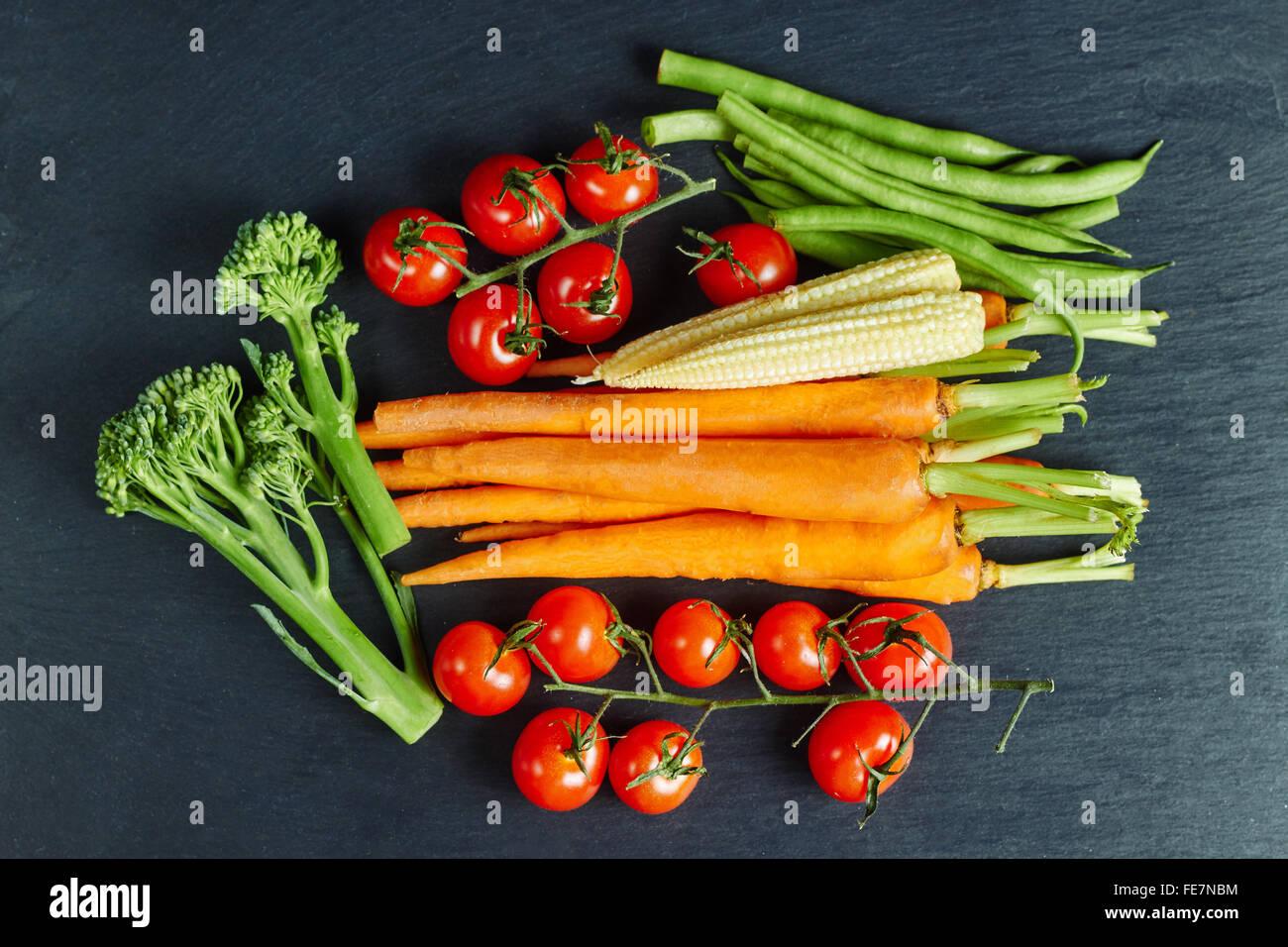 Fresh vegetables on a slate, organic food, flat lay - Stock Image