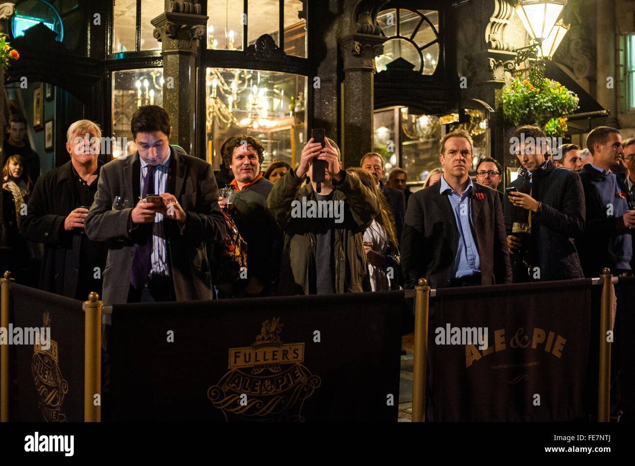 Pub onlookers, Million Mask March, London 2014 - Stock Image
