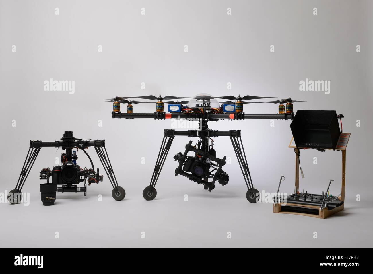Multirotor type civil drone used for aerial photography and aerial filming with different gimbals and control desk - Stock Image