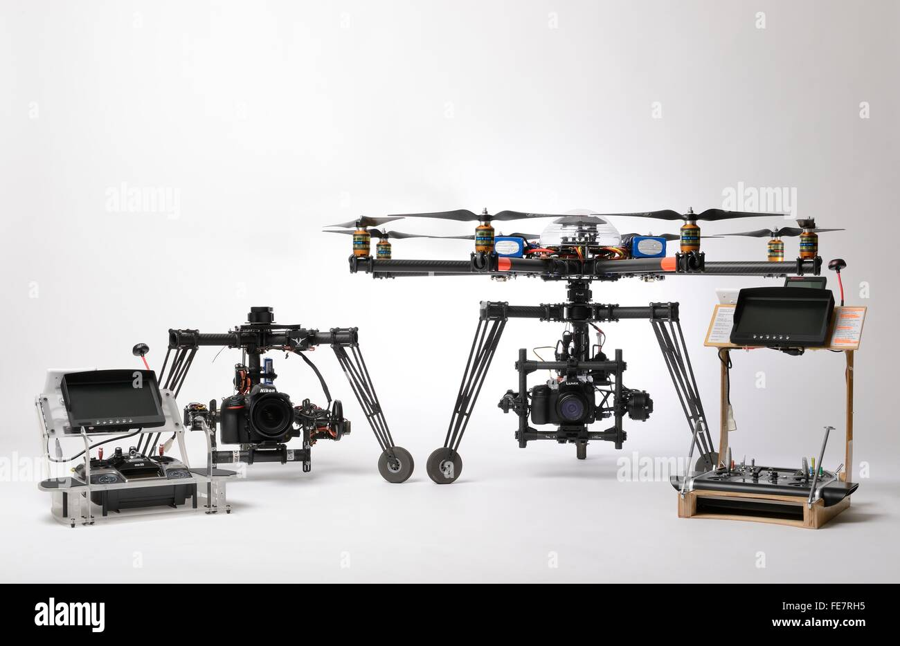 Multirotor type civil drone used for aerial photography and aerial filming with different gimbals and control desks. - Stock Image