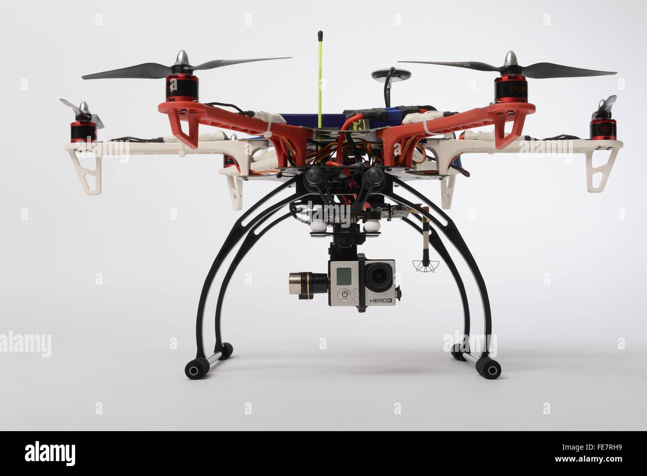 Small multirotor drone of the hexacopter type equipped with a stabilized gimbal holding a GoPro  typically used - Stock Image