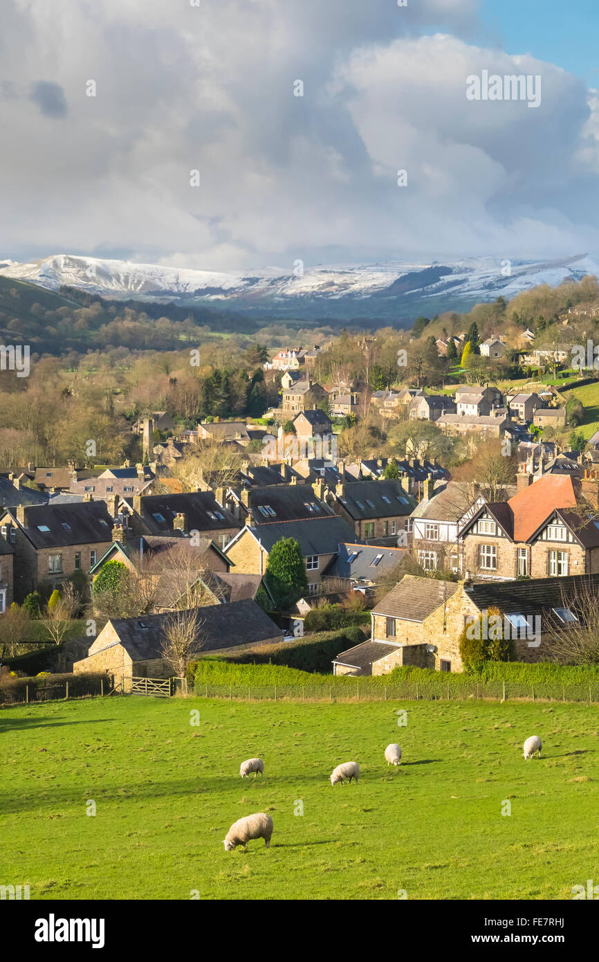 Hathersage in the Peak District in Derbyshire  beneath snow covered Mam Tor and Lose hill. - Stock Image