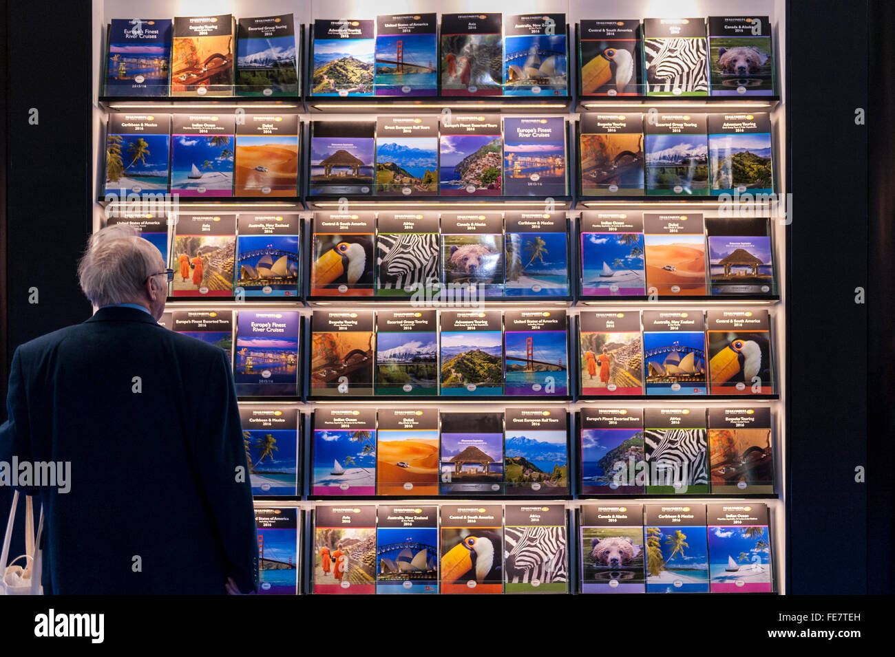 "London, UK.  4 February 2016. A visitor admires travel brochures to exotic places on the opening day of ""Destinations: Stock Photo"