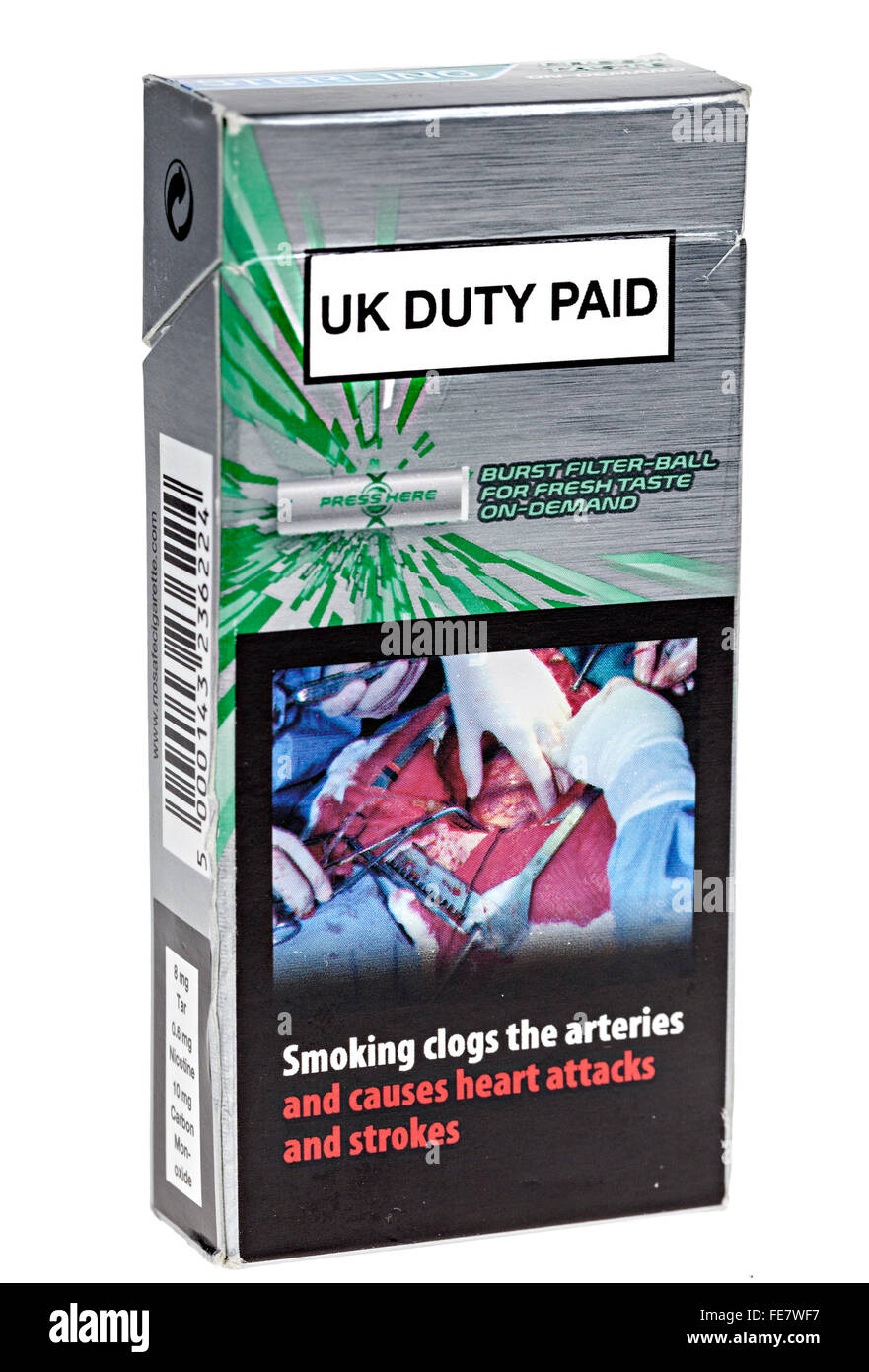 Cigarette packet with warning about smoking and heart attacks and UK Duty Paid - Stock Image
