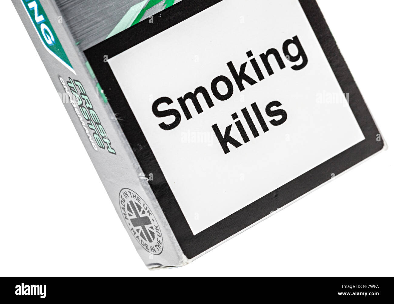 Smoking Kills notice on cigarette packet - Stock Image
