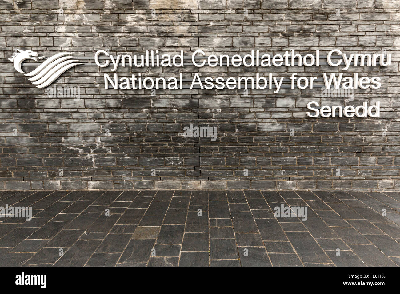 Bilingual sign on the Senedd, National Assembly for Wales, Cardiff, UK - Stock Image