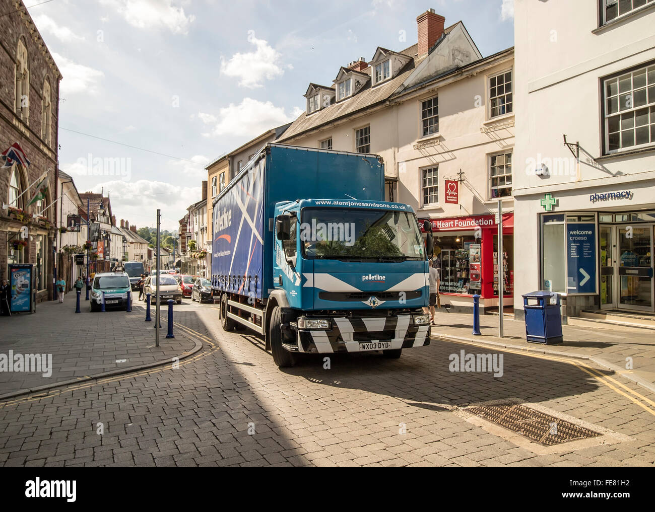 Lorry in town high street, Abergavenny, Wales, UK Stock Photo