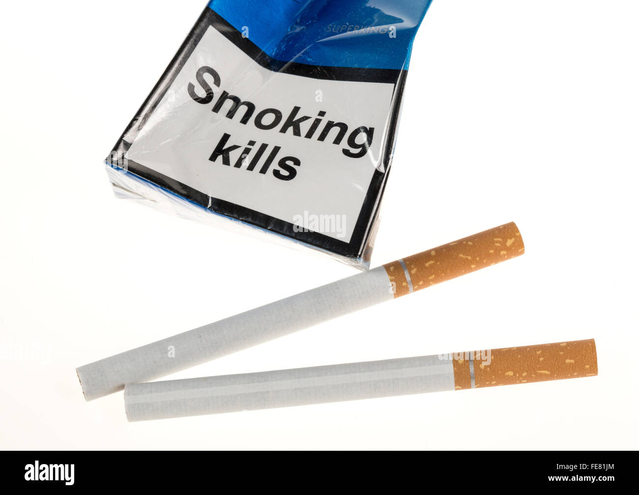 Smoking kills label on crushed cigarette packet with two cigarettes - Stock Image