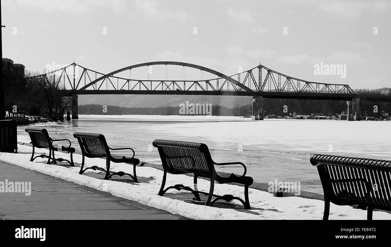 Empty Benches Overlooking Calm River - Stock Image