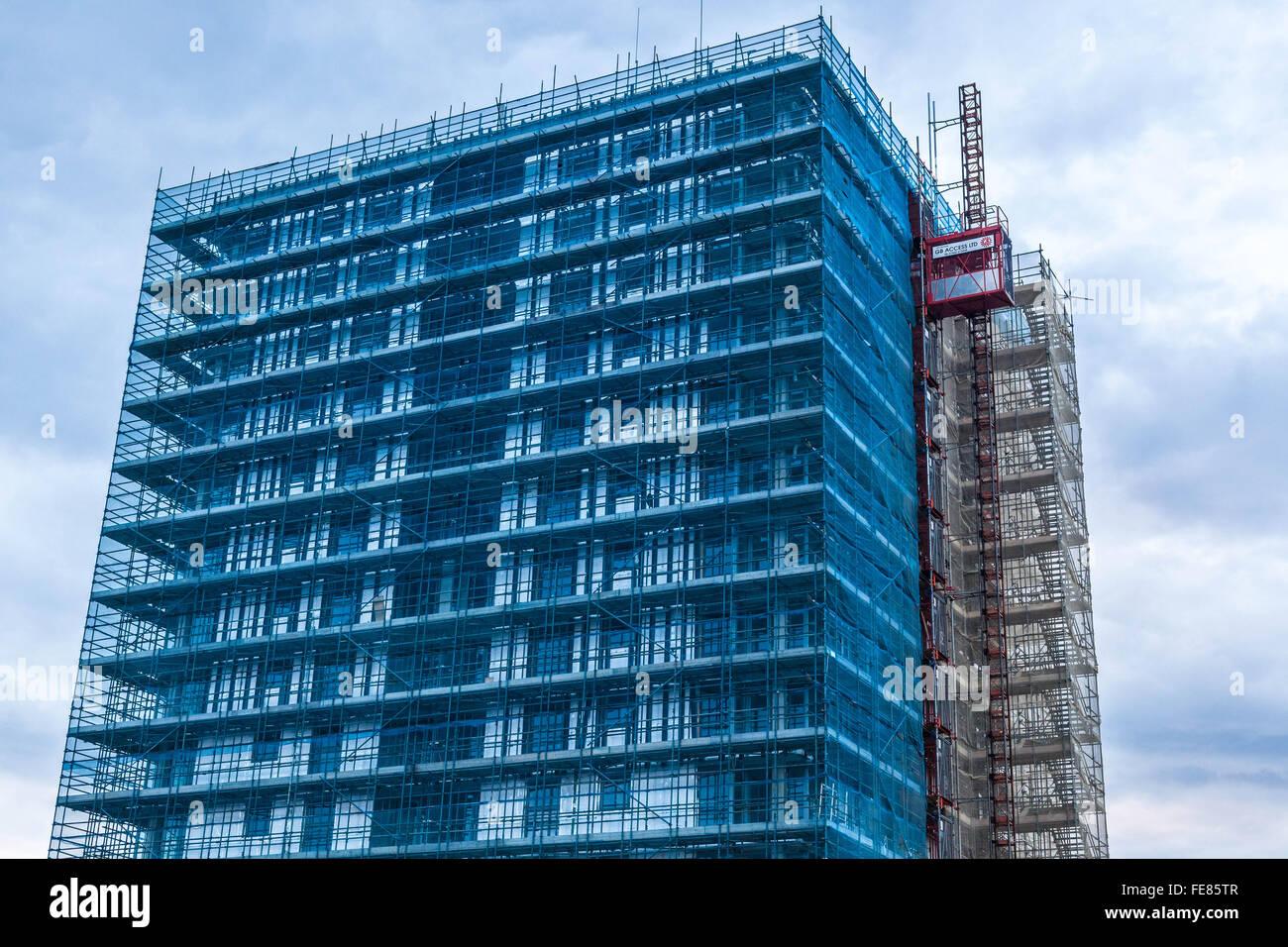Scaffolding netting on building, Edgware, Greater London, England, UK - Stock Image