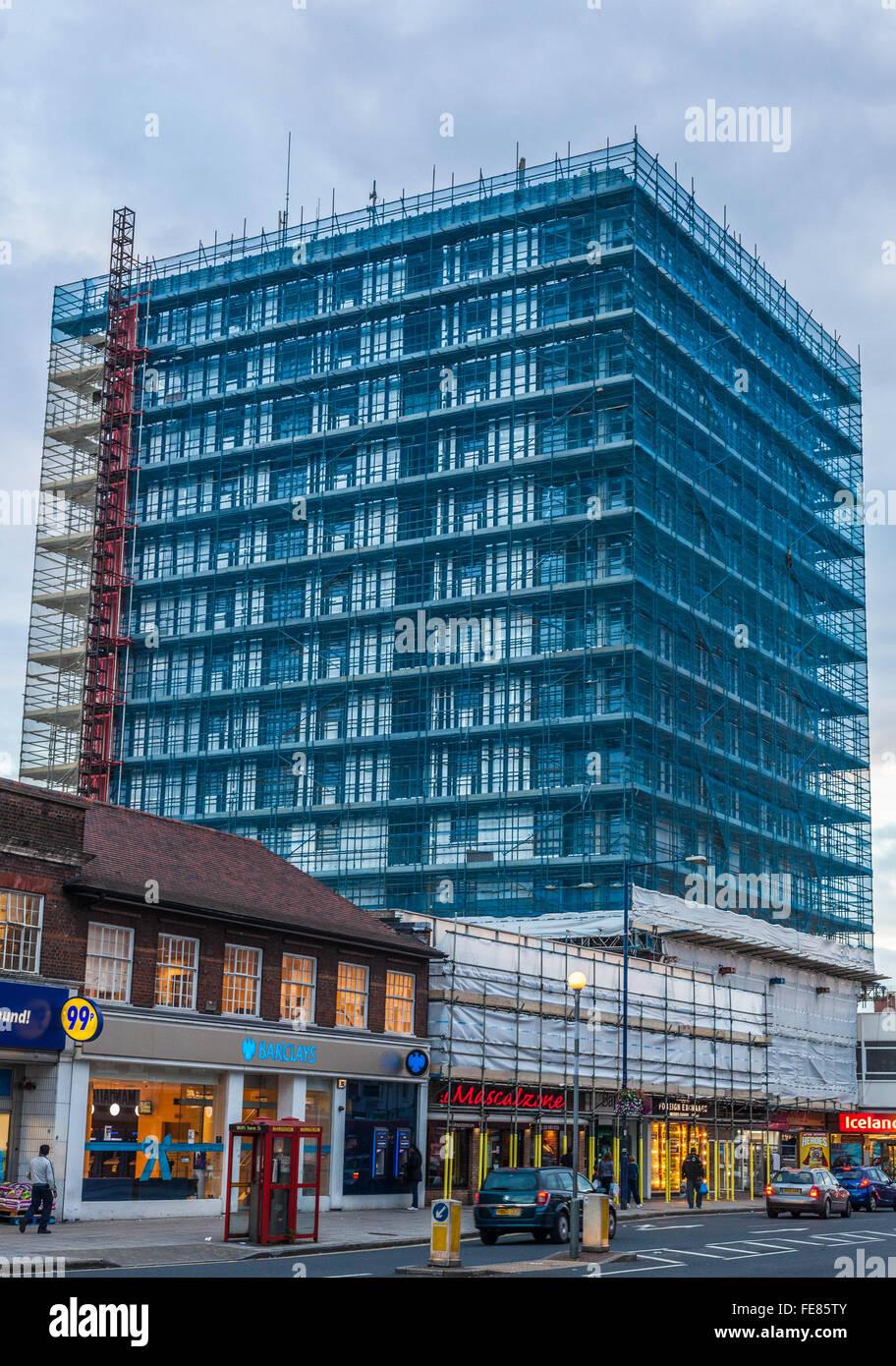 Scaffolding netting on building, Edgware, Greater London, England, UK. - Stock Image