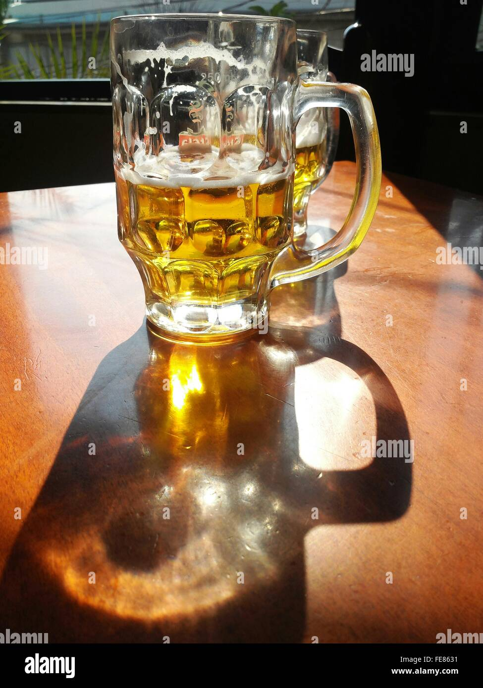 Beer Glasses Served On Table - Stock Image