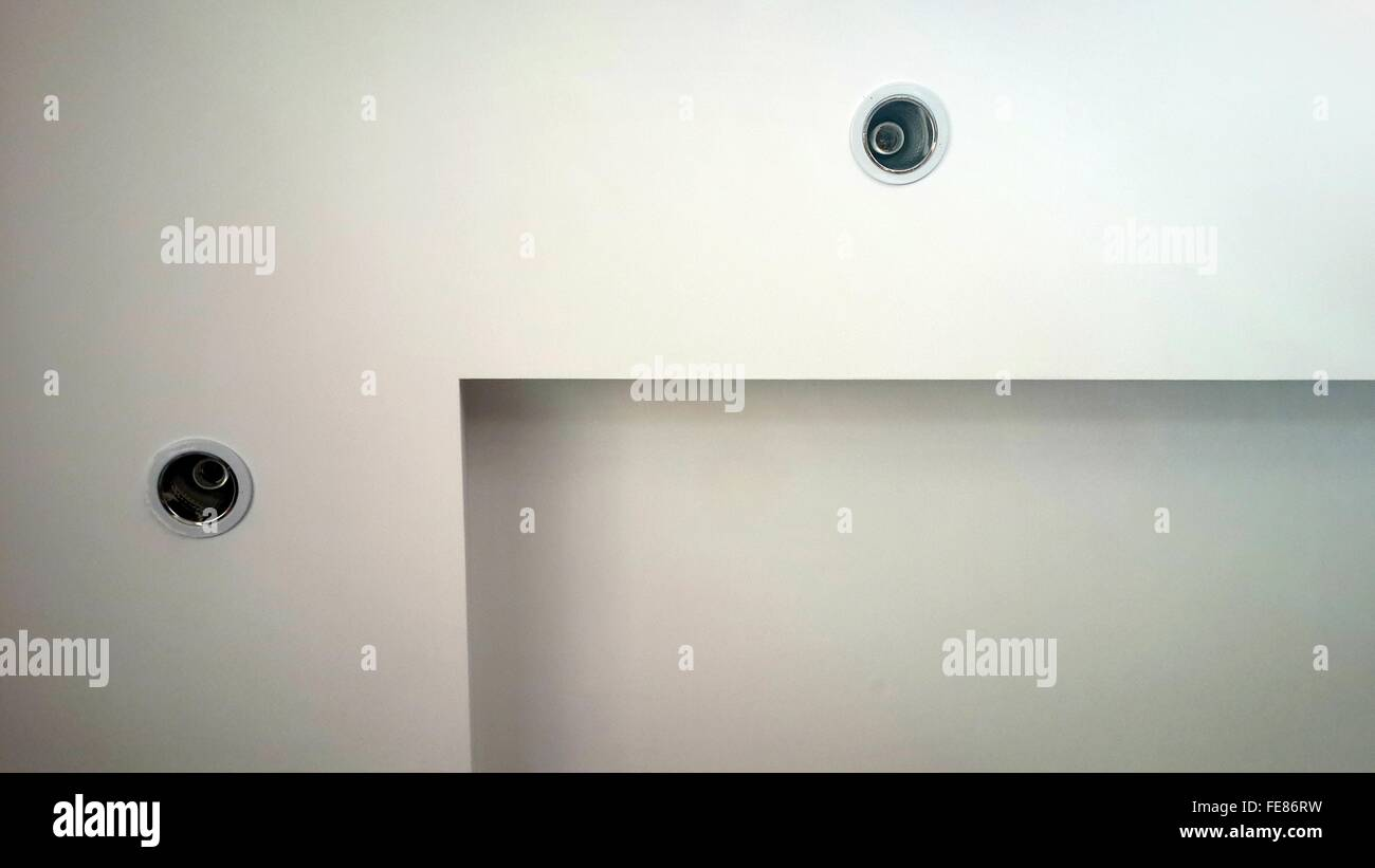 Recessed Lights On White Wall - Stock Image