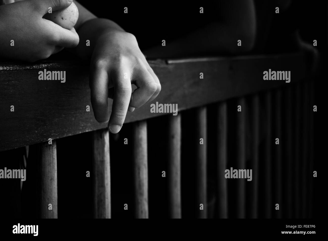 Close-Up Of Hand Of Disabled Child Over Railing - Stock Image
