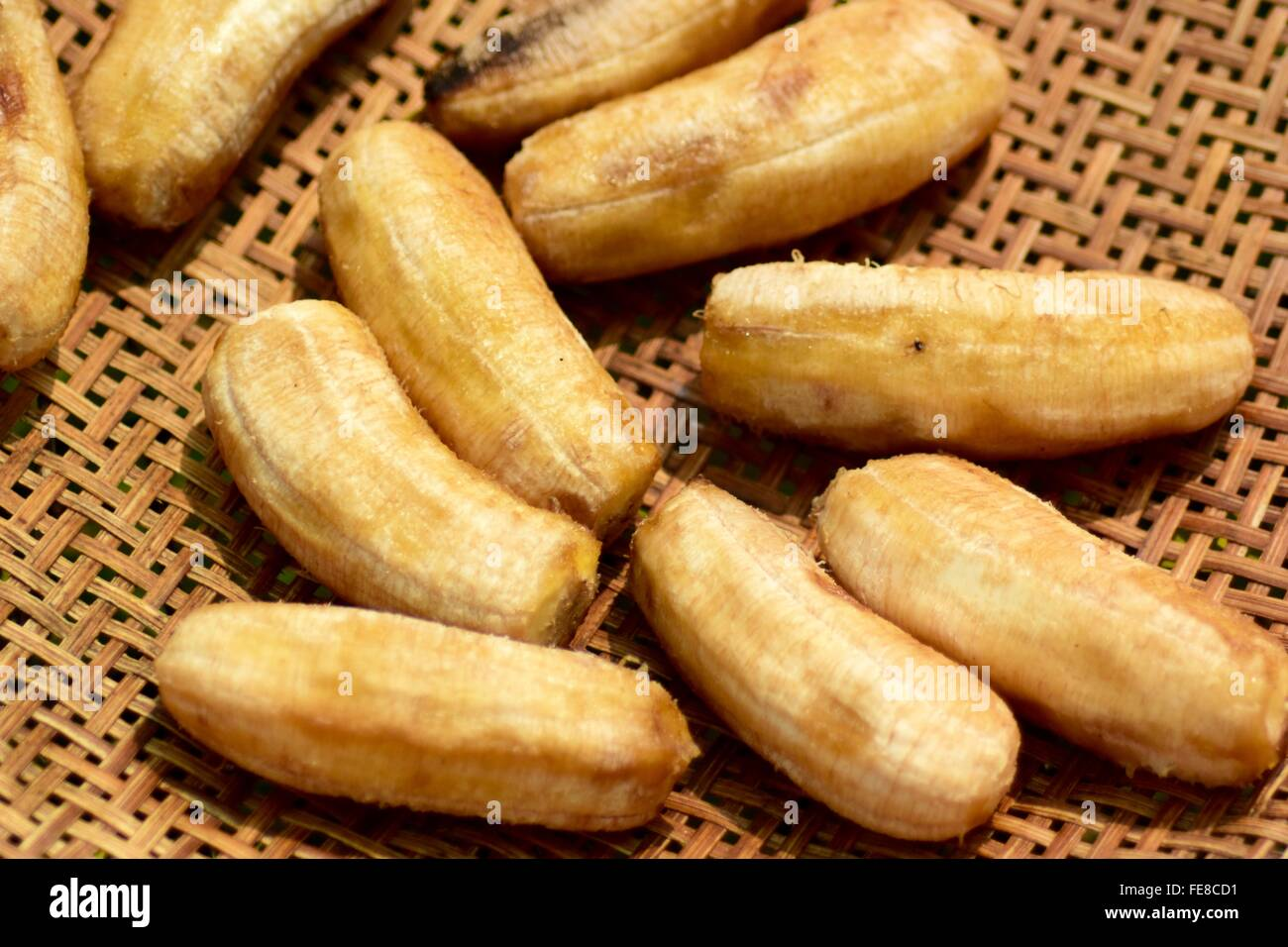 Close-Up Of Bananas Drying On Cane Platters - Stock Image