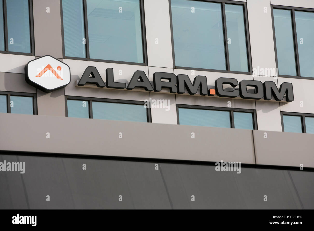 A logo sign outside of the headquarters of Alarm.com, Inc., in Tysons, Virginia on January 1, 2016. - Stock Image