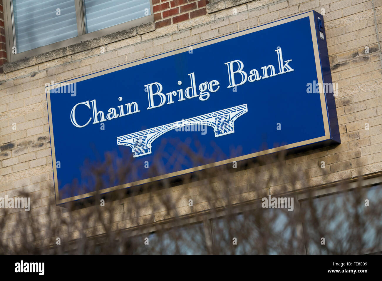 A logo sign outside of the Chain Bridge Bank in McLean, Virginia on January 1, 2016. The bank has only a single - Stock Image