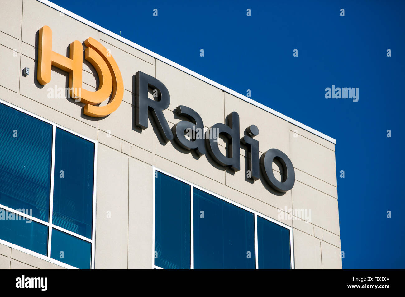 A logo sign outside of the headquarters of HD Radio in Columbia, Maryland on January 2, 2016. - Stock Image