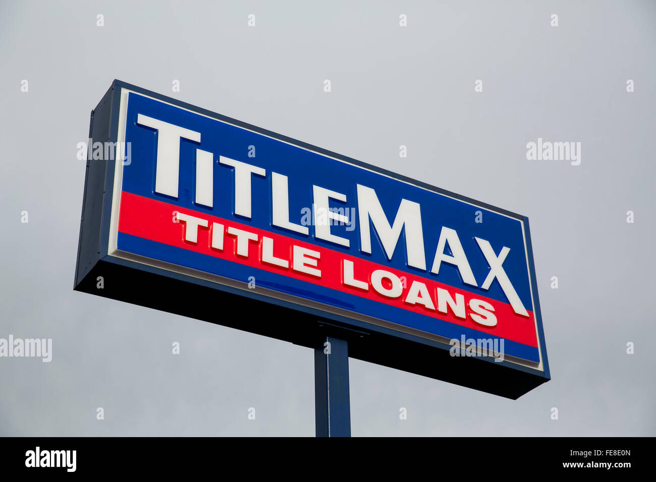 A logo sign outside of a TitleMax car title loan office in Tysons, Virginia on January 1, 2016. - Stock Image
