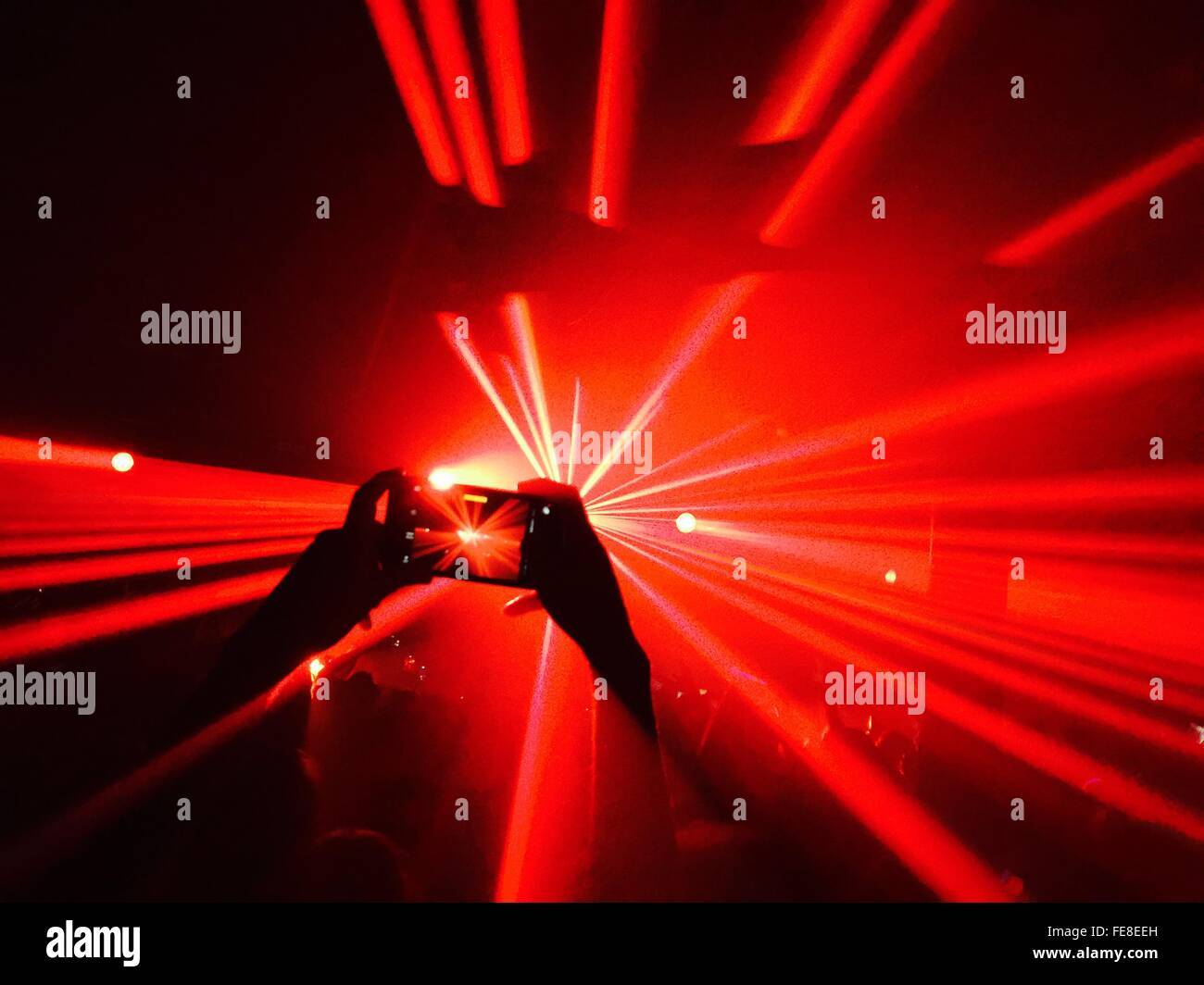 Person Taking Picture At Night Club Party - Stock Image