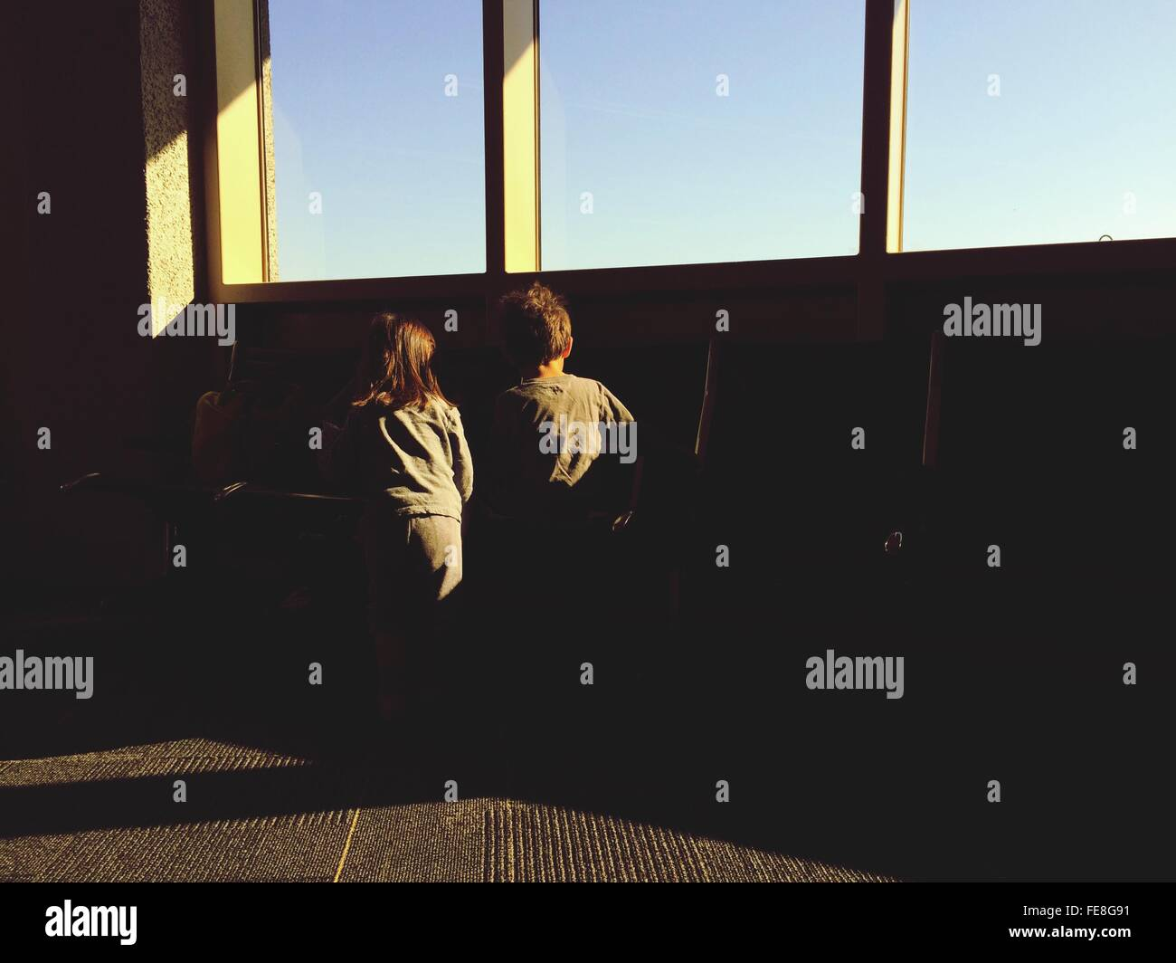 Rear View Of Siblings In San Diego International Airport - Stock Image