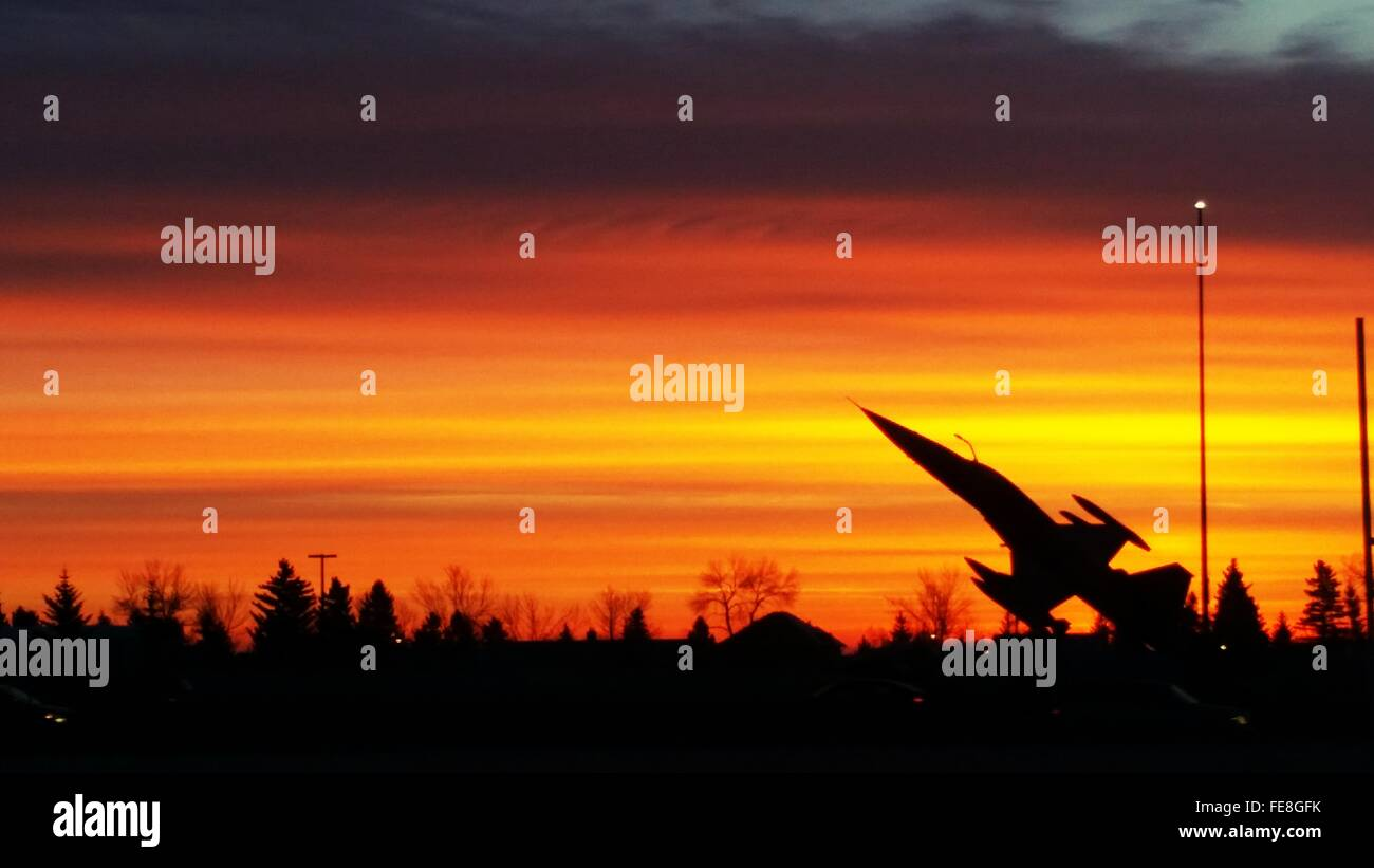 Silhouette Of Airplane Monument Against Orange Sky - Stock Image