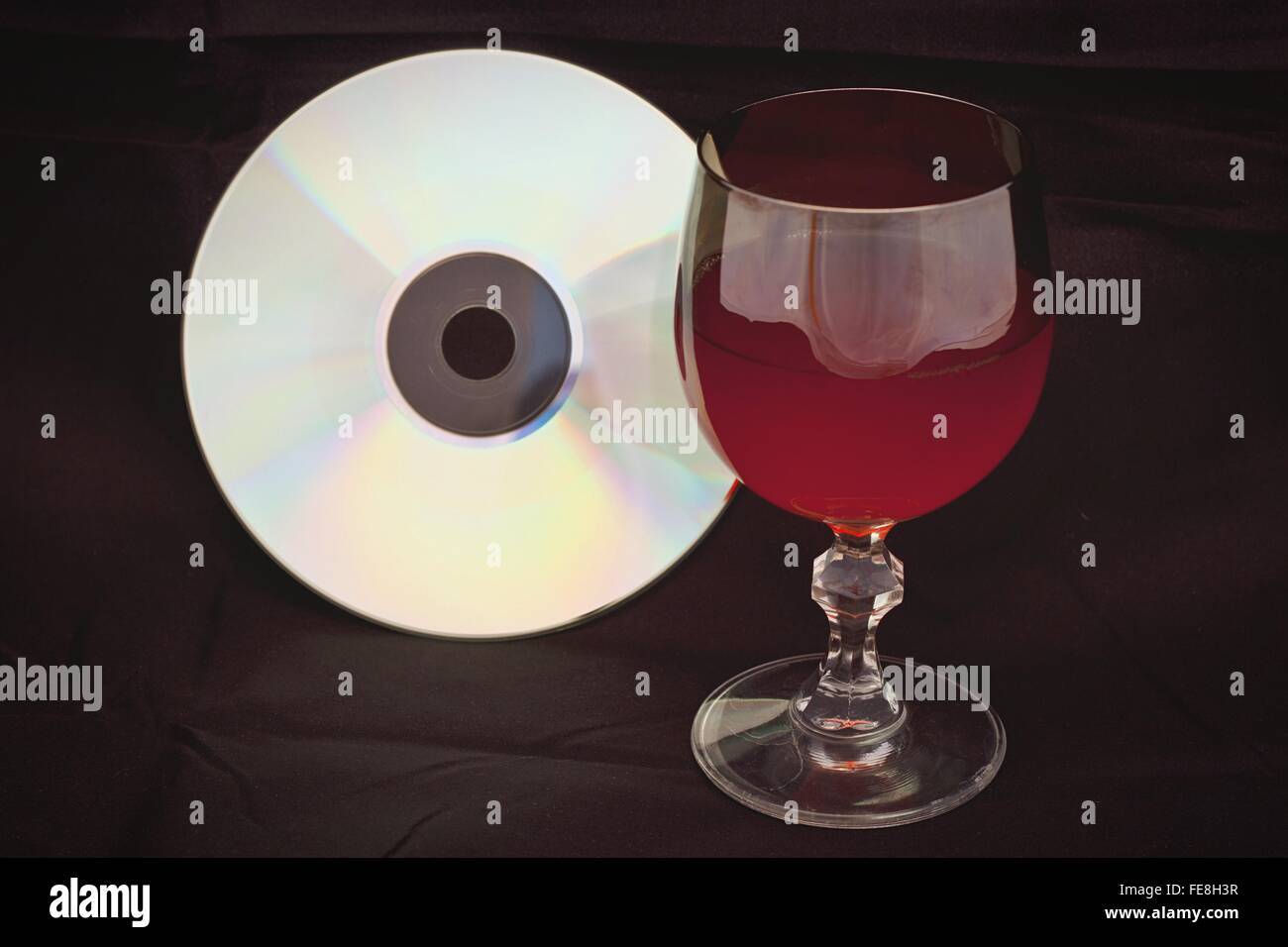 Red Wine In Glass By Compact Disc On Seat - Stock Image